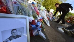 Une photo de Drummer Lee Rigby, tué à l'arme blanche, en pleine rue, par deux hommes affirmant venger les guerres engagées par le Royaume-Uni dans des pays musulmans, le mercredi 22 mai.