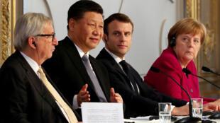 Jean-Claude Juncker, Xi Jinping, Emmanuel Macron y Angela Merkel durante una conferencia de prensa en el Palacio del Elíseo, este 26 de marzo de 2019 en París.
