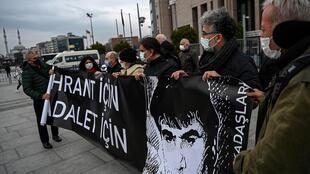 """Demonstrators held banners reading """"For Hrant, For Justice"""" in front of the Istanbul court"""