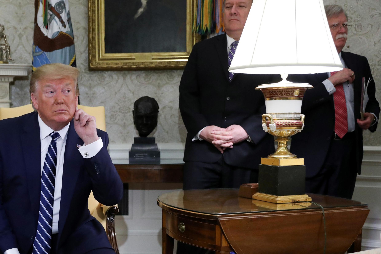 Le président des États-Unis Donald Trump, son conseiller spécial à la sécurité John Bolton et son secrétaire d'État Mike Pompeo. Washington, le 20 juin 2019.