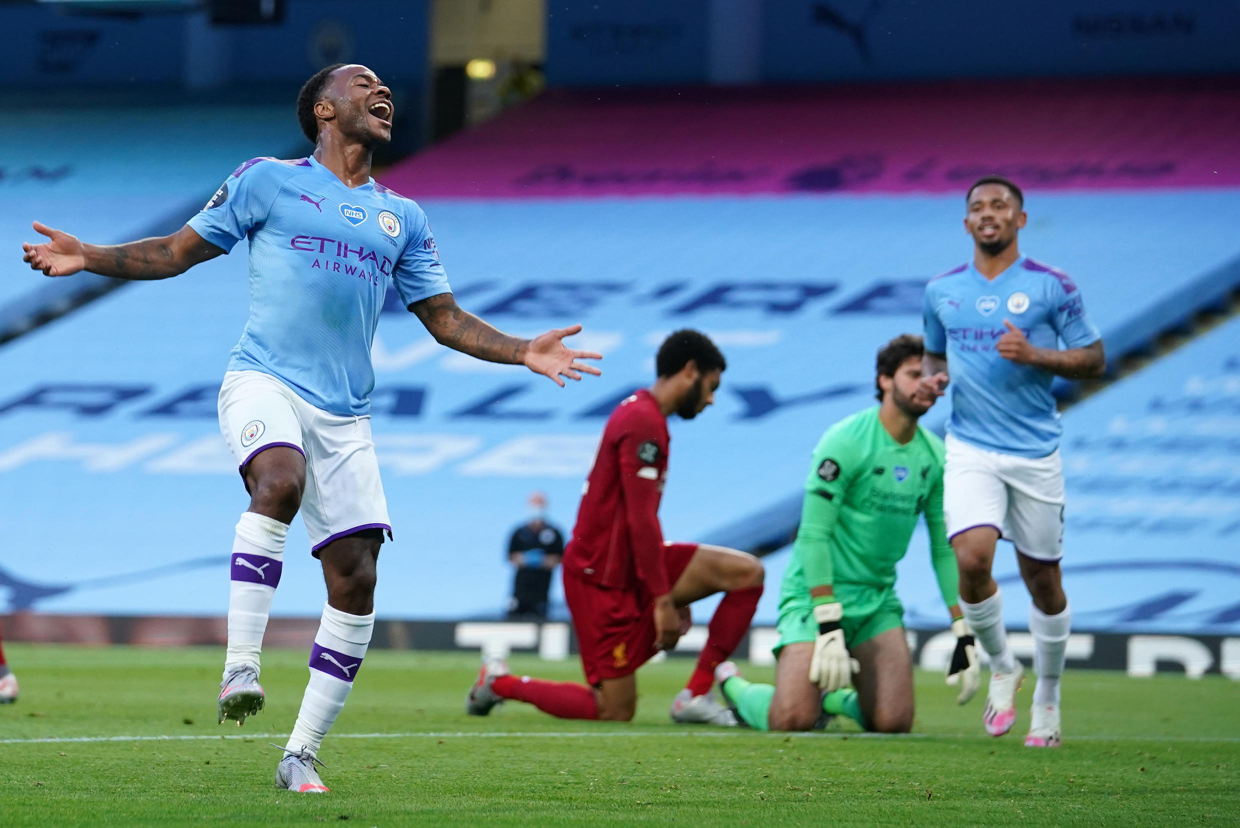 Manchester City's Raheem Sterling (left) celebrates scoring against his former club Liverpool