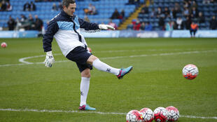 Wycombe Wanderers goalkeeping coach Barry Richardson warms up before the game against Aston Villa on 9 January, 2016.