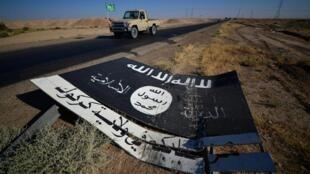 An Islamic State group banner near the Al-Fatiha army base in Iraq