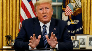 美国总统特朗普3月11日在白宫就新冠疫情发表讲话。