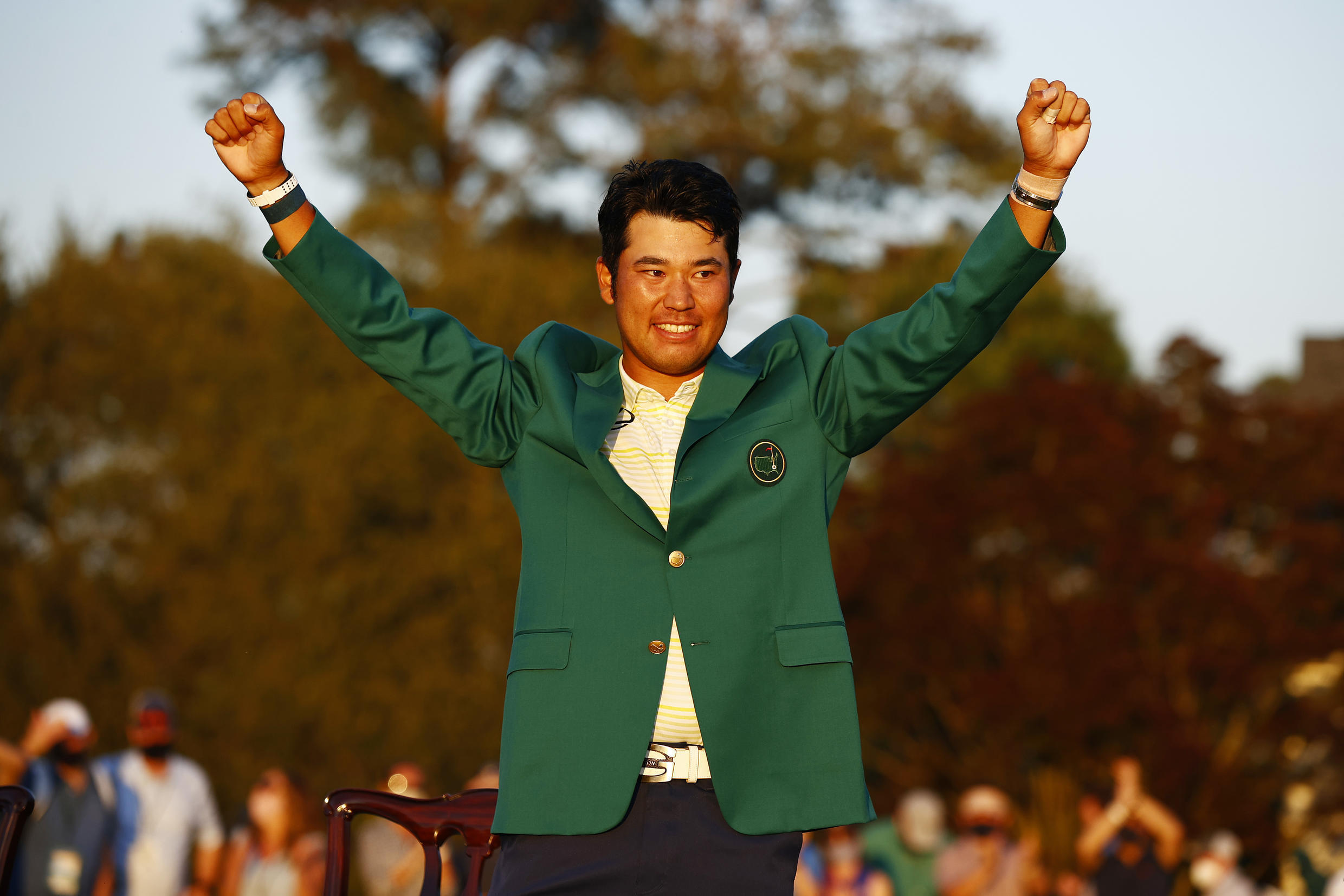 Japan's Hideki Matsuyama celebrates after receiving the green jacket symbolic of a Masters champion for his victory Sunday at Augusta National