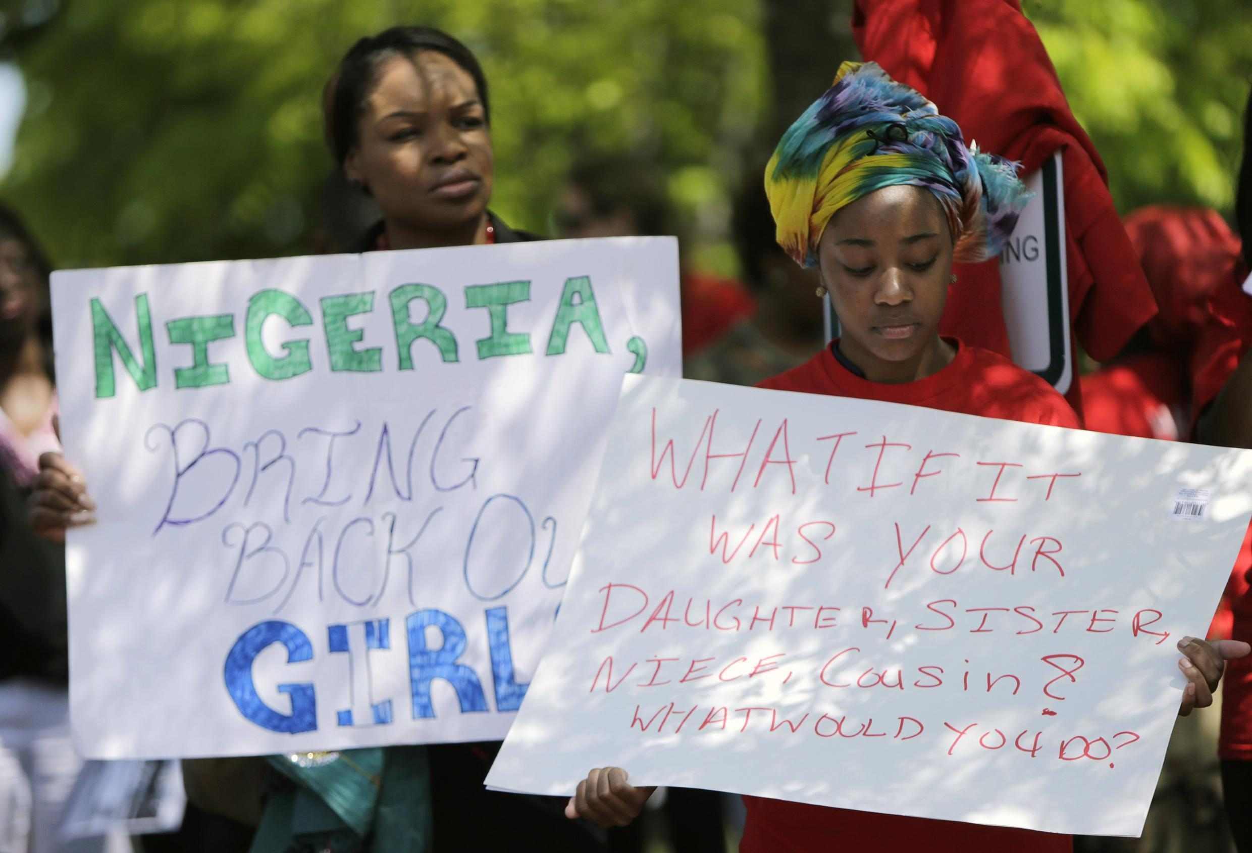 Women demonstrate against the Boko Haram kidnapping outside the Nigerian embassy in Washington
