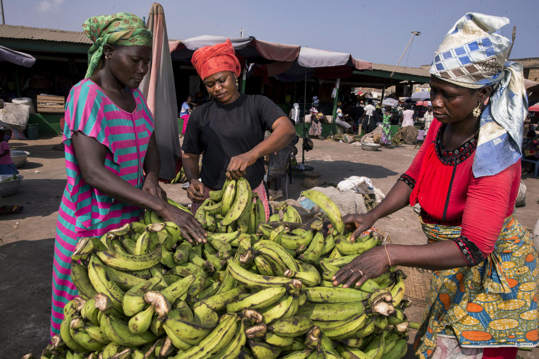 Informal workers Zenabu Abrahamanu (right) and Asetu Somana (left) sell bananas at Agbogbloshie Market