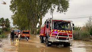 Firefighters respond to floods in Villeneuve-sur-Beziers, in the south of France.