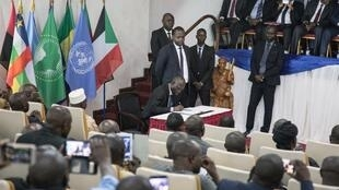 A participant signs the Khartoum peace agreement during a ceremony in Bangui on 6 February 2019.
