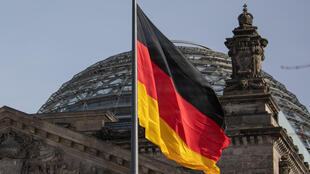 The German flag flys outside the Reichstag, the building which houses the Bundestag, the German lower house of parliament, in Berlin.