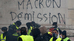 """Macron resign!"" - graffiti on a Yellow Vest protest"
