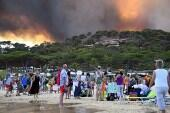 People watch the fire burning at Bormes-les-Mimosas