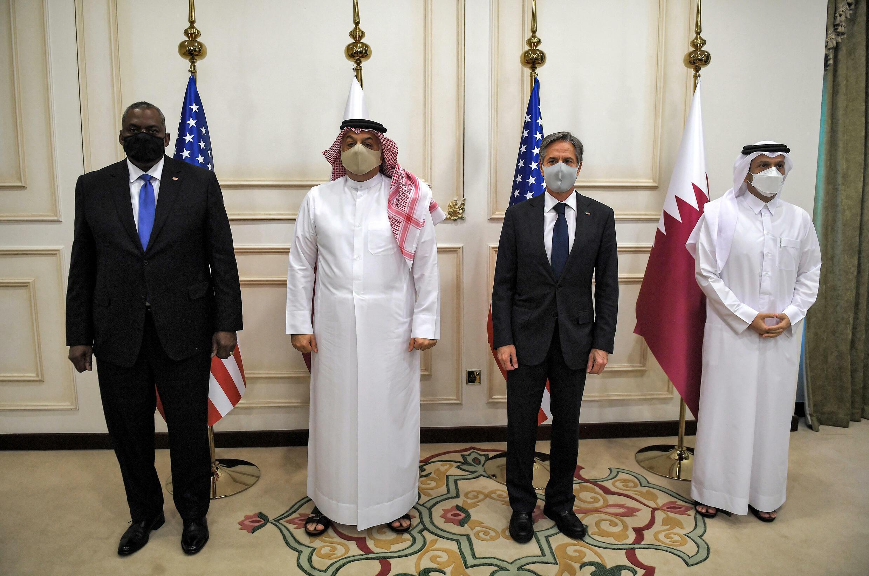 US Secretary of State Antony Blinken (2nd-R) and Secretary of Defense Lloyd Austin (L) with Qatari Deputy Prime Minister and Foreign Minister Mohammed bin Abdulrahman Al Thani (R) and Qatari Deputy Prime Minister and Defense Minister Dr. Khalid bin Mohammed Al-Attiyah (2nd-L)