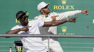 Lewis Hamilton poses with Olympic champion Usain Bolt after the United States Grand Prix in Austin.