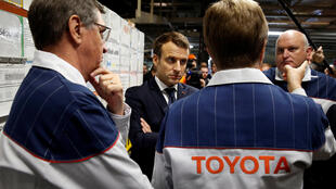 French President Emmanuel Macron visits Toyota's plant with director Luciano Biondo (R) in Onnaing, France, on Monday