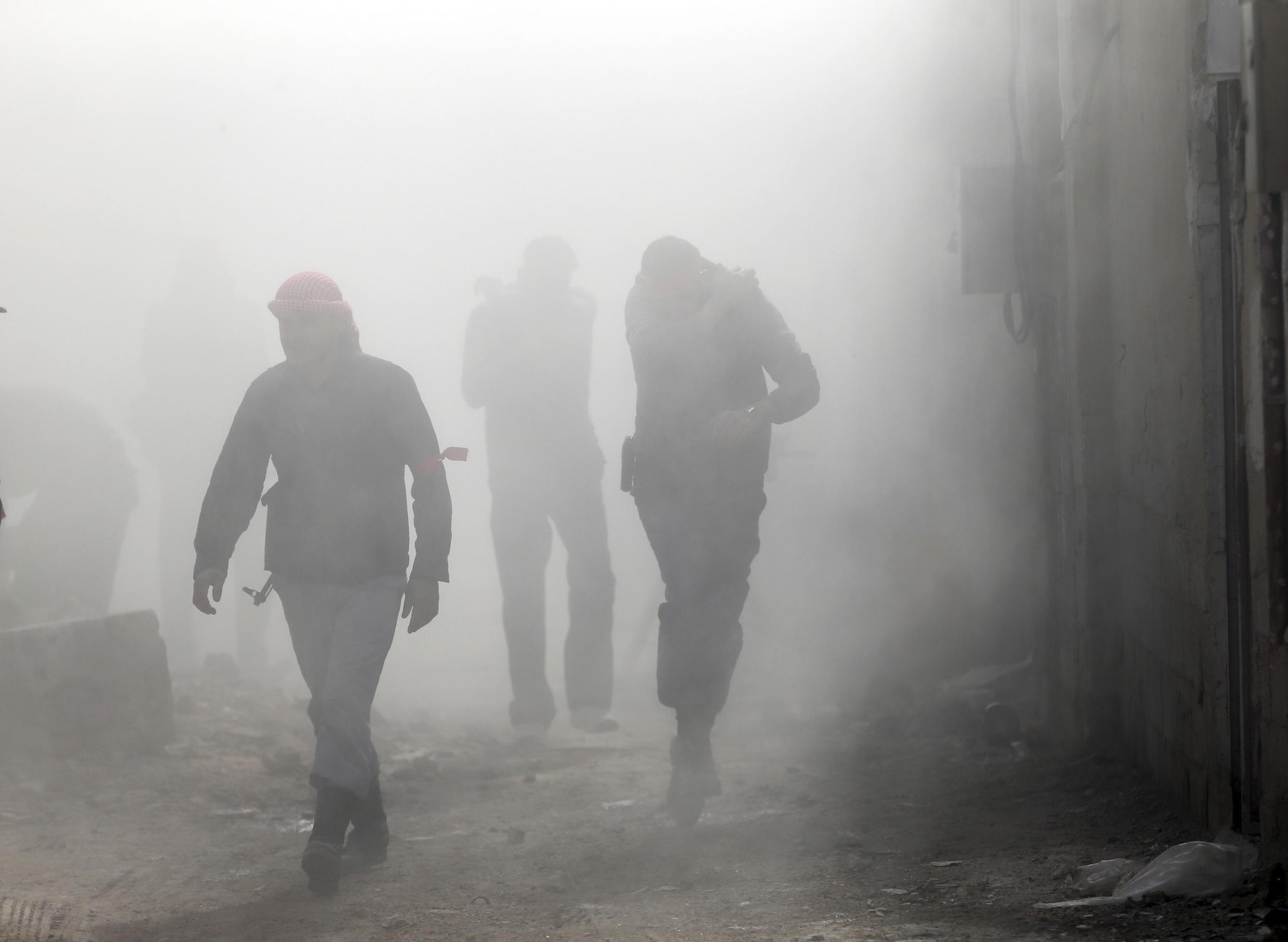 Syrian rebels after an explosion in Damascus