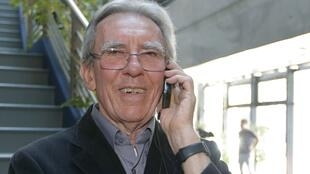 French scientist Jean-Pierre Sauvage speaks on the phone at the University of Strasbourg on Wednesday following the announcement of Nobel Chemistry Prize.