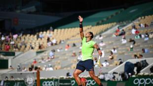 Champion's style: Rafael Nadal serves to Alexei Popyrin