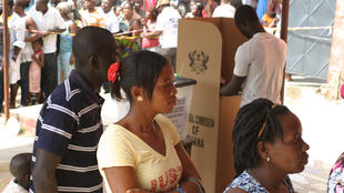Voters waiting in line at a polling station in the Santa Maria area of Accra
