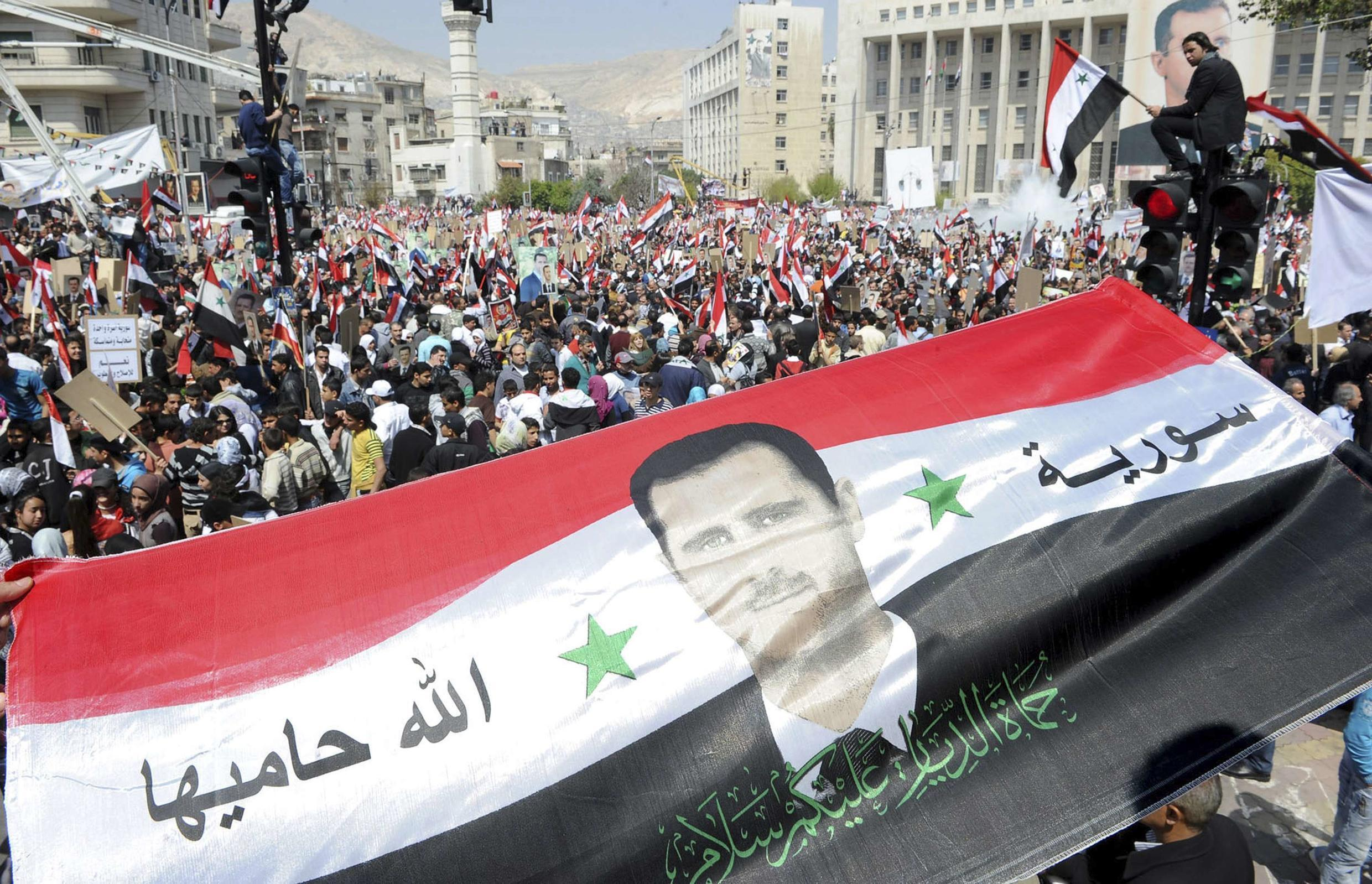 Assad supporters demonstrate on Tuesday