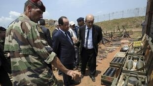 French Defence Minister Jean-Yves Le Drian and President François Hollande with troops in CAR