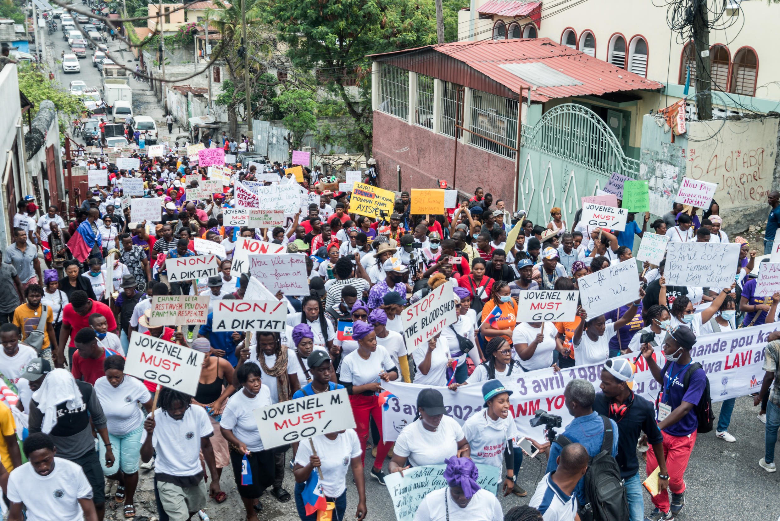 Haitians marching in Port-au-Prince in April 2021 to denounce political instability and gang violence behind a spike in recent kidnappings