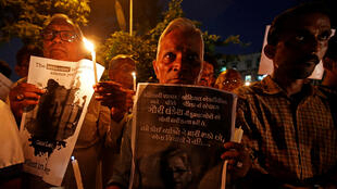 People hold placards and candles during a vigil for Gauri Lankesh, a senior Indian journalist who according to police was shot dead outside her home on Tuesday by unidentified assailants in southern city of Bengaluru, in Ahmedabad, India, September 6, 2017