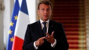 Le président Emmanuel Macron lors de sa déclaration après une vidéoconférence internationale sur l'épidémie à l'Élysée, à Paris, lundi 4 mai 2020.