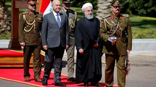 Tổng thống Irak Barham Salih và tổng thống Iran Hassan Rohani (P) trong lễ tiếp đón tại Bagdad, ngày 11/03/2019.