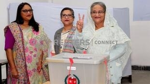Prime Minister Sheikh Hasina gestures after casting her vote in the morning during the general election in Dhaka, Bangladesh, December 30, 2018.