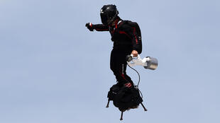 Franky Zapata on his flyboard performs while holding the F1 trophy ahead of the Formula One Grand Prix de France at the Circuit Paul Ricard in Le Castellet, southern France, on June 23, 2019.