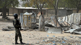 A Cameroonian soldier patrols in Fotokol, after clashes between the Cameroonian army and Boko Haram on February 17 , 2015