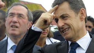 French Interior Minister  Claude Guéant (L) with President Nicolas Sarkozy