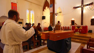 A funeral is held for two Christians killed in the Baghdad bomb attacks