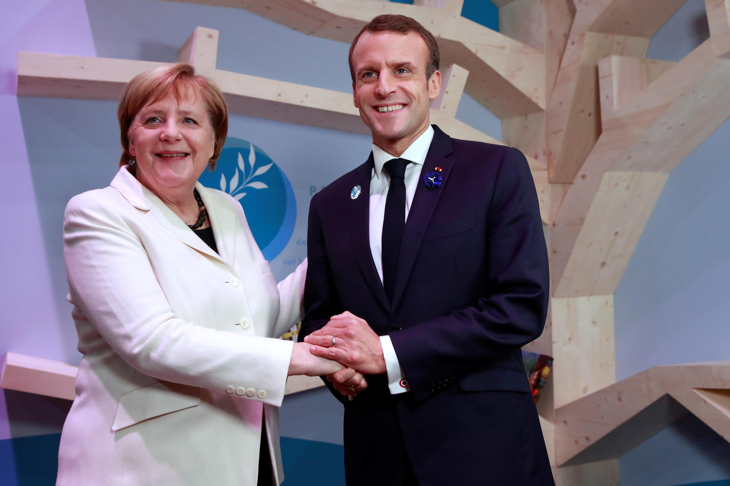 German chancellor Angela Mekel with French president Emmanuel at the Paris Peace Forum