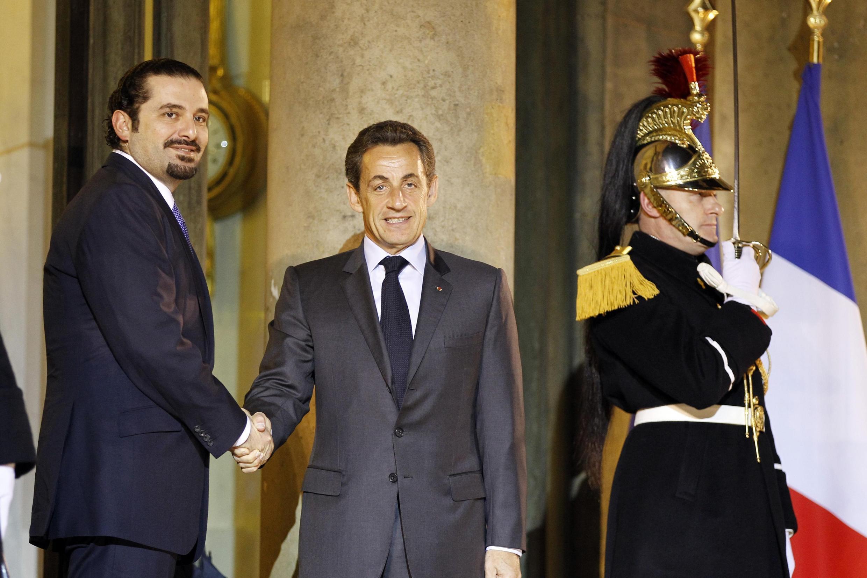 France's President Nicolas Sarkozy greets Lebanon's Prime Minister Saad Hariri as he arrives at the Elysée Palace in Paris