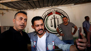 A Palestinian takes a selfie with a member of Fatah recently freed by Hamas, 1 October 2017.