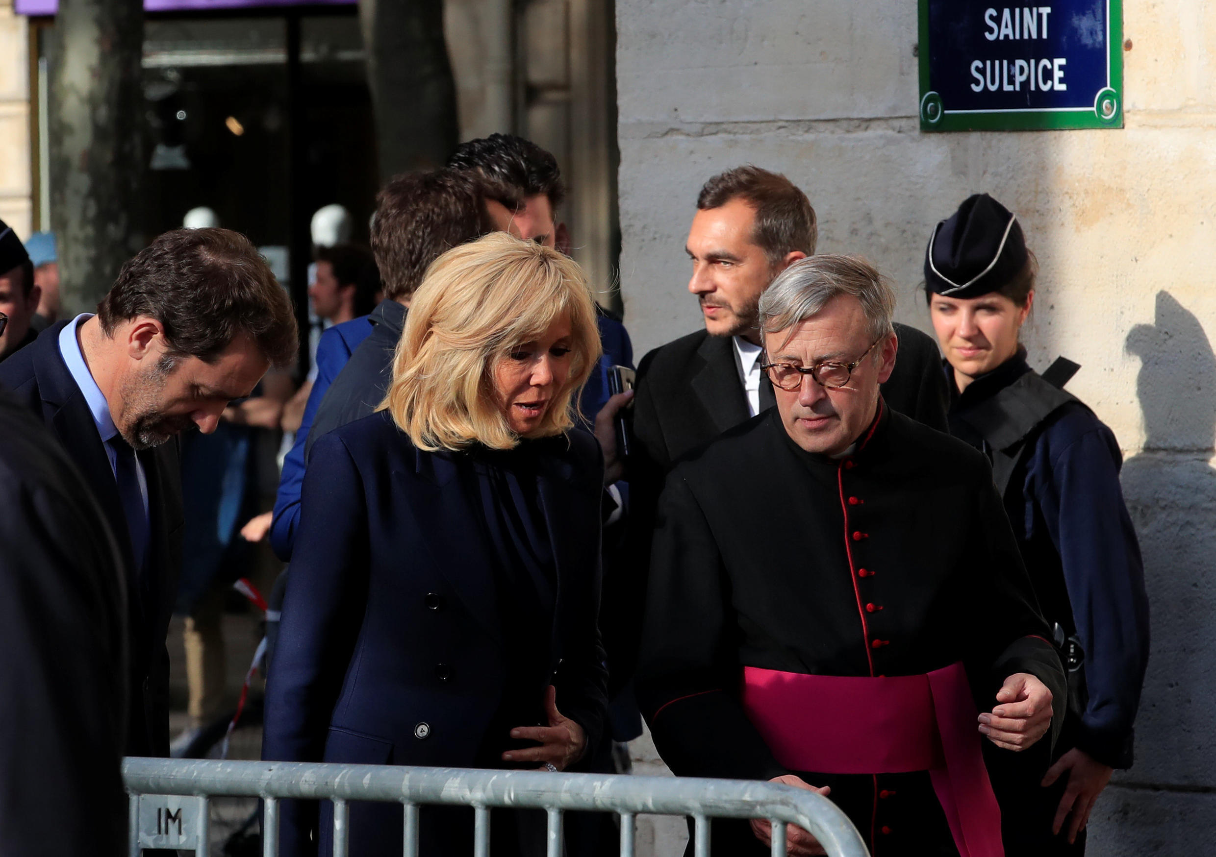 Brigitte Macron, wife of French President Emmanuel Macron, arrives to attend a mass at Saint Sulpice church two days after a massive fire devastated large parts of the gothic structure of Notre-Dame Cathedral in Paris, France, April 17