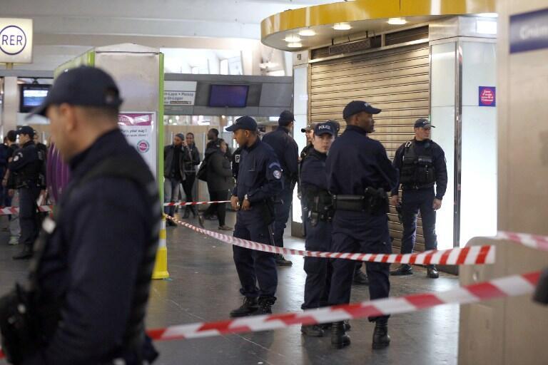 French police at the scene of Saturday's attack in Paris's La Défense district