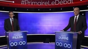 François Fillon (L) with rival opponent Alain Juppé in France's final rightwing primary debate on Thursday 24 November.