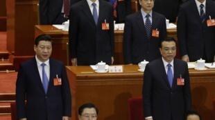 O presidente Xi Jinping e o primeiro-ministro chinês, Li Kequiand, na abertura da Assembleia Popular chinesa nesta quarta-feira, 5 de março de 2014.