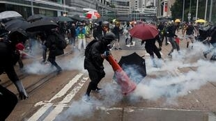Hong Kong police use tear gas against masked protesters on 6 October, 2019.