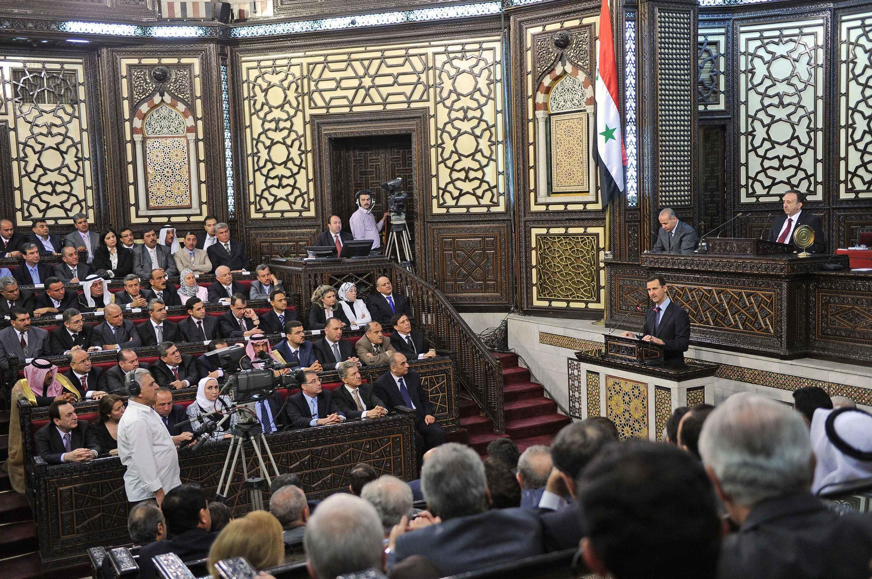 """Em seu discurso, Assad questionou a existência de um movimento de contestação na S'iria que classificou de """"terrorismo"""" vindo do exterior."""