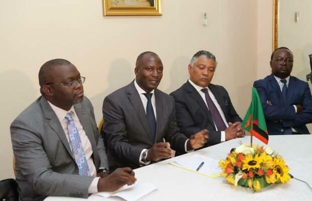 Zambian minister of mines Richard Musukwa(centre) flanked by justice minister Given Lubinda and attorney general Likando Kalaluka, during press conference at State House in Lusaka, 23 July, 2019