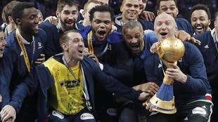 France's handball team celebrates its gold medal.