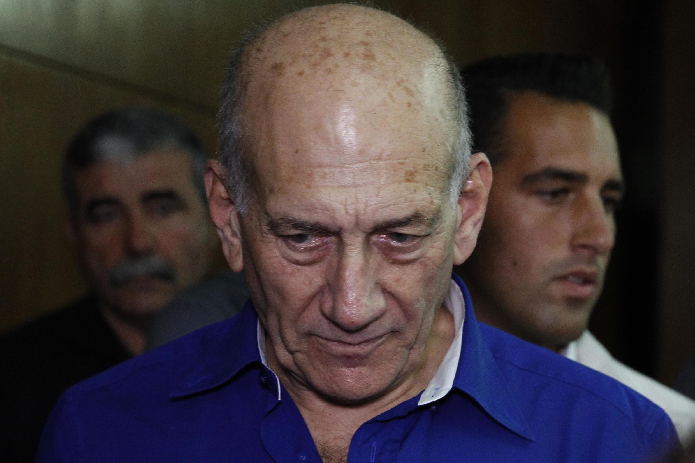 Tsohon Firaministan Isra'ila Ehud Olmert a lokacin da ya halarci kotu a Tel Aviv ranar 13 ga watan Mayu  2014.
