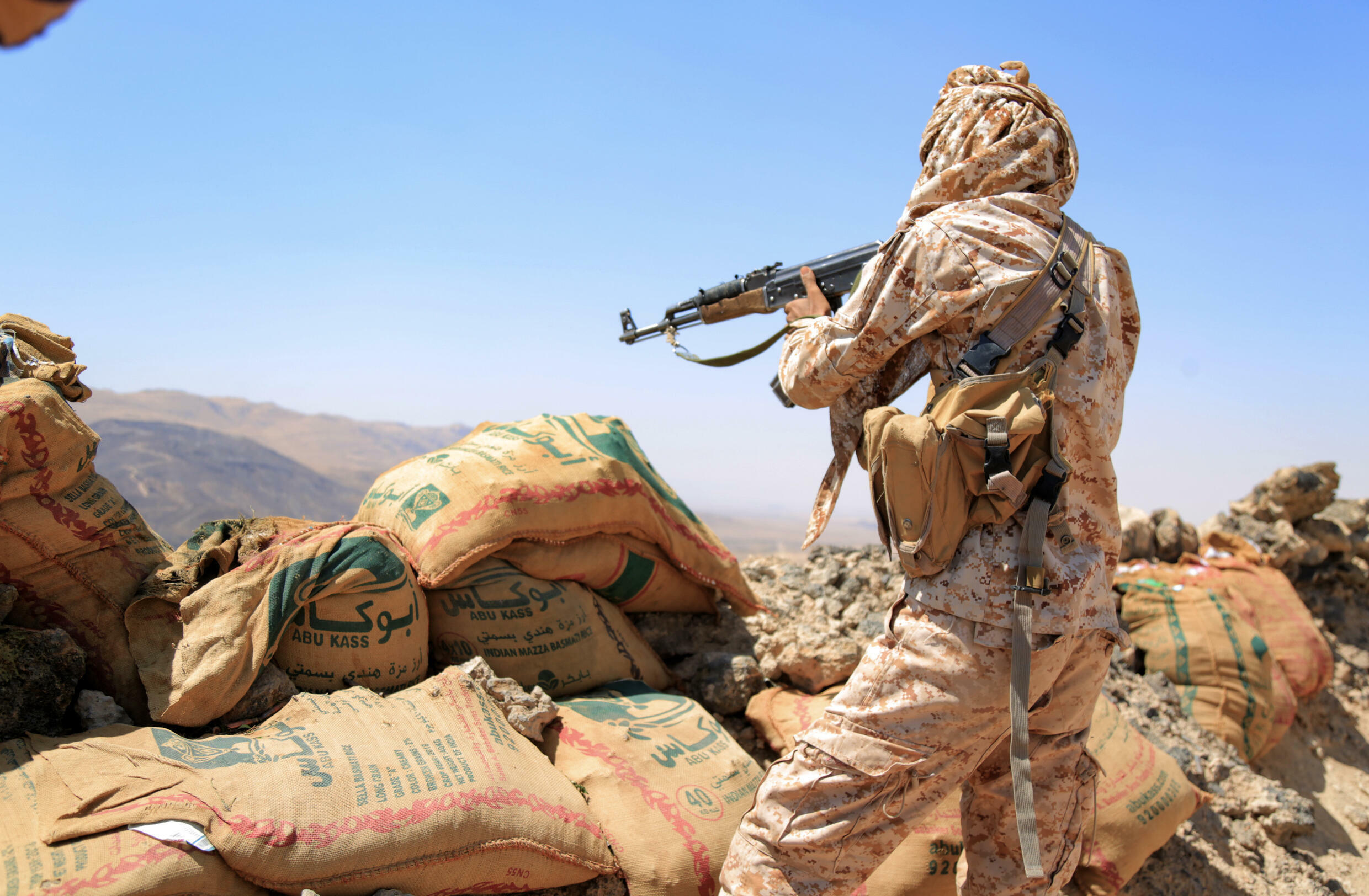 A fighter loyal to Yemen's Saudi-backed government mans a position near the frontline facing Iran-backed Huthi rebels in the province of Marib on October 17, 2021