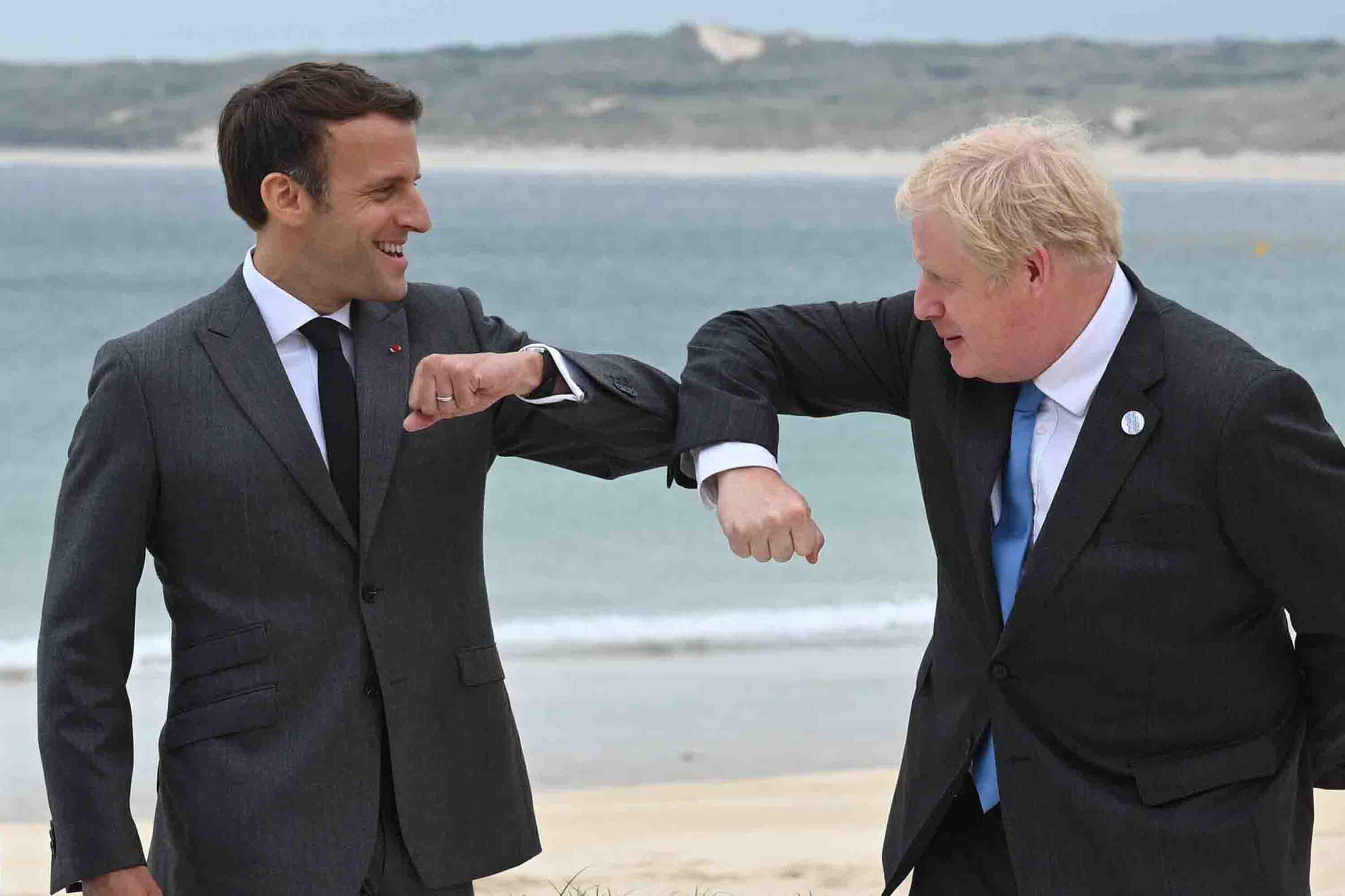 British PM Boris Johnson (R) said he hoped for cooperation with France