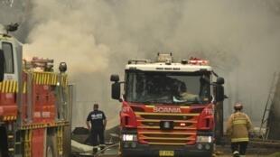 Les pompiers australiens n'ont pas de répit, même à Noël pour tenter de circonscrire les feux qui sévissent dans tout le pays comme à Sydney.