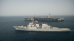Khu trục hạm USS Higgins cùng với hàng không mẫu hạm USS Theodore Roosevelt trên Vịnh Ả Rập ngày 15/03/2018. Ảnh minh họa